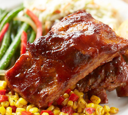 Ribs with a side of corn and beans.