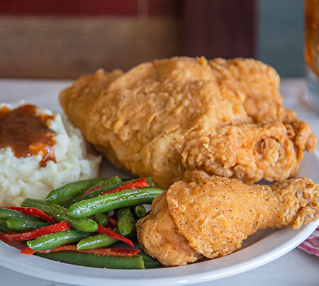 Southern Fried Chicken served with mash potatoes and gravy and green beans